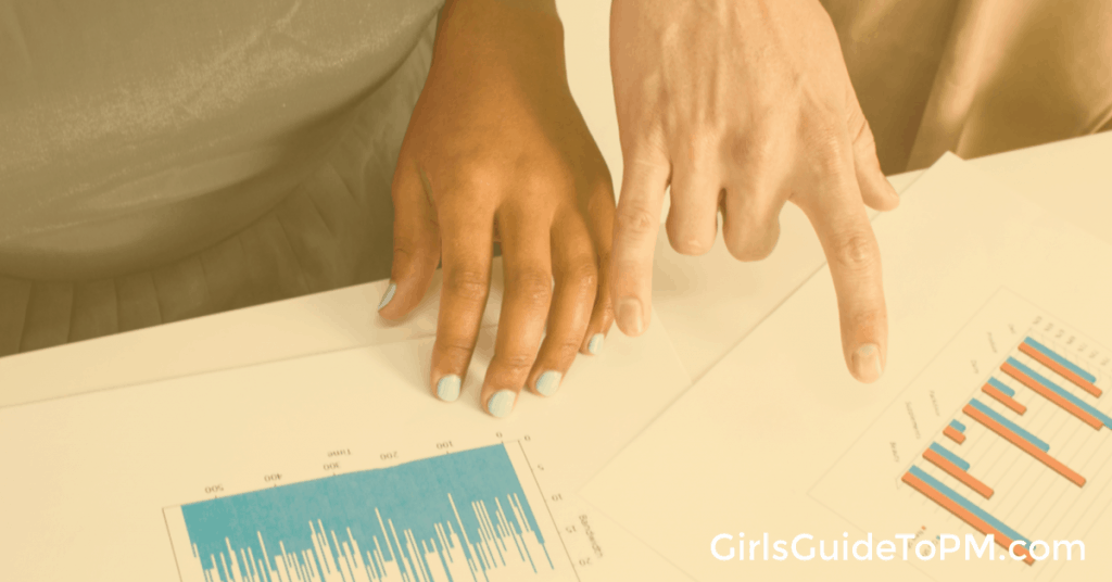 hands pointing at printed graphs