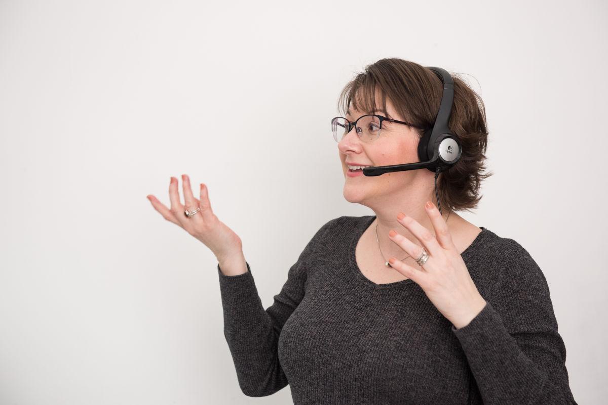 elizabeth harrin talking over bluetooth headset